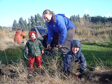 The Jacques family planting trees right at the beginning of the Bushy Point Project!